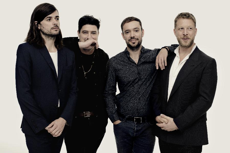 Mumford & Sons Get Acoustic Again On World Cafe
